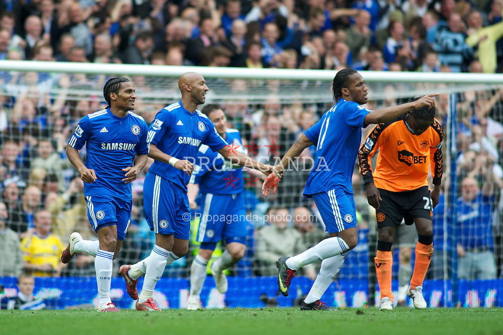 LONDON, ENGLAND - Sunday, May 9, 2010: Chelsea's Didier Drogba celebrates his 2nd goal after scoring from the penalty spot to make it 5-0 against Wigan Athletic during the final Premiership match of the season at Stamford Bridge. (Pic by Gareth Davies/Propaganda)