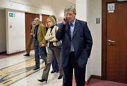 Jean-Claude Juncker, Luxembourg's prime minister and president of the Euro Group, right, speaks speaks on his mobile phone before a meeting on macro-economics, at the European Council headquarters, in Brussels, Belgium, Monday, Feb. 9, 2009. (Photo © Jock Fistick)