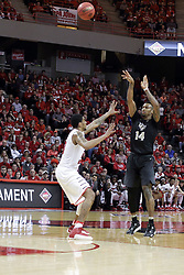 20 March 2017:  Nick Banyard shoots over Deontae Hawkins(23) during a College NIT (National Invitational Tournament) 2nd round mens basketball game between the UCF (University of Central Florida) Knights and Illinois State Redbirds in  Redbird Arena, Normal IL