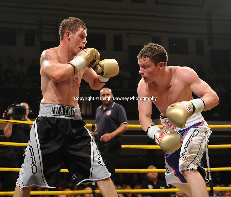 Peter Vaughan (blue/white shorts) defeats Wayne Goddard at Quarter Final Two  - The Light Middleweights II. York Hall, Bethnal Green, London, UK. 15th September 2011. Photo credit: © Leigh Dawney.