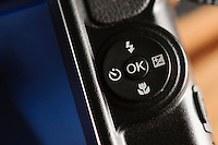 Control dial and button on digital compact camera