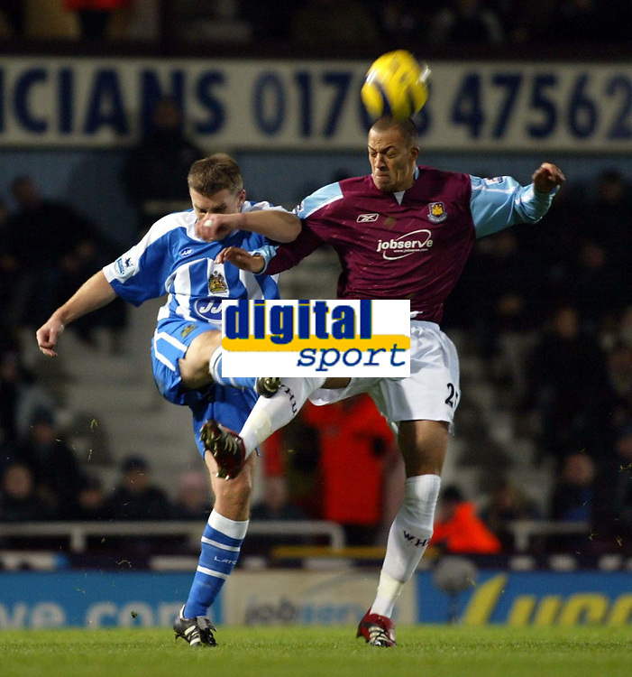 Photo: Chris Ratcliffe.<br />West Ham United v Wigan Athletic. The Barclays Premiership. 28/12/2005.<br />Bobby Zamora (R) of West Ham tussles with Graham Kavanagh of Wigan.