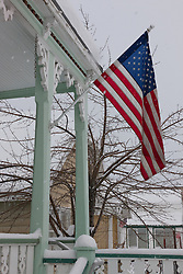 """American Flag in Snowy Truckee"" - Photograph of an American flag, shot while it was snowing in Downtown Truckee, California."