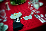 The table setting and reserved seat for former U.S. Senator and astronaut John Glenn at the Marine Corps Heritage Foundation 33rd Annual Awards Dinner.  Photo by Johnny Bivera