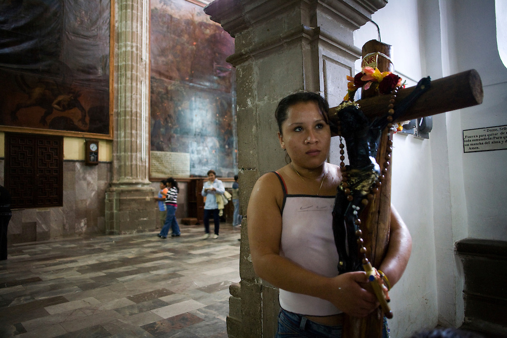 Rosalio Orihuela, 25, stands in the church in Chalma after being blessed with holy water.  Chalma is the second most important pilgrimage site in Mexico.  People come from all over the country to visit the Senor de Chalma. They often arrive wearing crowns made of flowers, and leave the crowns at the church.