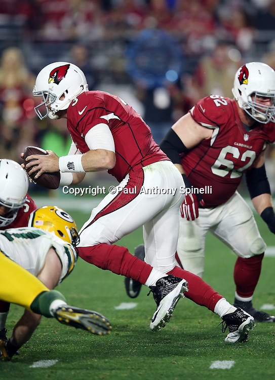 Arizona Cardinals quarterback Carson Palmer (3) scrambles away from pressure in overtime during the NFL NFC Divisional round playoff football game against the Green Bay Packers on Saturday, Jan. 16, 2016 in Glendale, Ariz. The Cardinals won the game in overtime 26-20. (©Paul Anthony Spinelli)