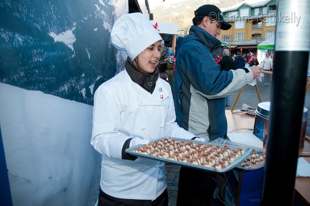 Lindt chocolates serves pralines to waiting guests at the House of Switzerland during the 2010 Olympic Winter Games in Whistler, BC Canada.