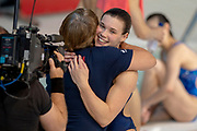 Grace Reid of Great Britain smiles and is congratulated by her coach after qualifying in the Women's Individual 3m dive during the FINA/CNSG Diving World Series 2019 at London Aquatics Centre, London, United Kingdom on 19 May 2019.