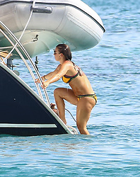 EXCLUSIVE: Coleen Rooney is spotted paddle boarding while on holiday in Barbados as husband Wayne Rooney takes pics and video. 30 May 2017 Pictured: Coleen Rooney. Photo credit: Queensofthenorth/MEGA TheMegaAgency.com +1 888 505 6342