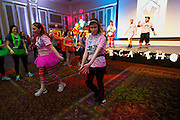 Bobcat Dance-A-Thon leaders, Corinne Bailey and Hailey Schafer dance down a runway. Bailey is a sophmore dance student while Schafer is a Marketing Major with Dance Minor.