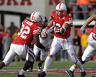 University of Nebraska quarterback Zac Taylor (13) hands off to Brandon Jackson (32) in the second half against Missouri at Memorial Stadium in Lincoln, Nebraska, November 4, 2006.  The Huskers defeated the Tigers 34-20.<br />