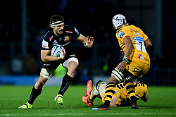 Don Armand of Exeter Chiefs is challenged by Nizaam Carr of Wasps - Mandatory by-line: Ryan Hiscott/JMP - 30/11/2019 - RUGBY - Sandy Park - Exeter, England - Exeter Chiefs v Wasps - Gallagher Premiership Rugby