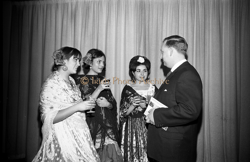 09/02/1966<br /> 02/09/1966<br /> 09 February 1966<br /> Airborne Travel Agency Film Reception at the Irish Sugar Co. Theatre at Earlsfort Terrace,<br /> Dublin. Pictured prior to the continental film show were three Spanish students in national dress, members of the English LanguageStudies school for foreign students who received guests at the reception (l-r): Miss Catalina Rosales; Miss Amparo Moreno;  and Miss Adelina Tost with  John D. O'Neill, Manager of Airborne Travel Agency at the Theatre.