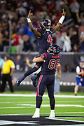 Houston Texans quarterback Deshaun Watson (4) gets a lift high in the air from Houston Texans center Nick Martin (66) as they celebrate after Watson throws a 49 yard touchdown pass that gives the Texans a 35-20 fourth quarter lead during the NFL week 8 regular season football game against the Miami Dolphins on Thursday, Oct. 25, 2018 in Houston. The Texans won the game 42-23. (©Paul Anthony Spinelli)