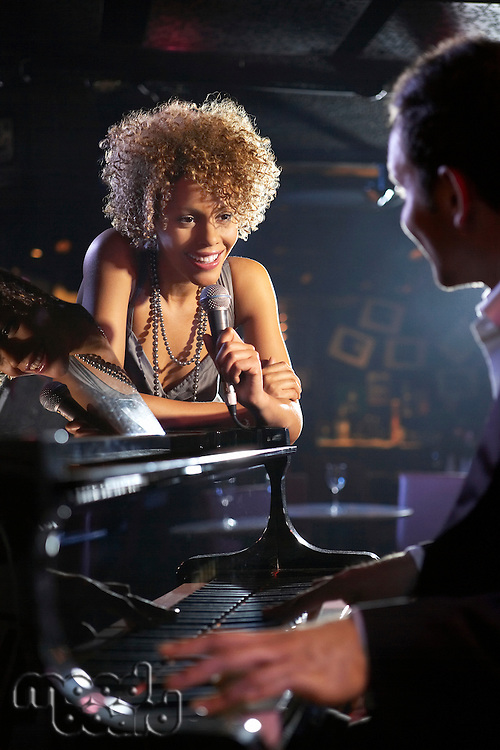 Jazz singer and pianist on stage