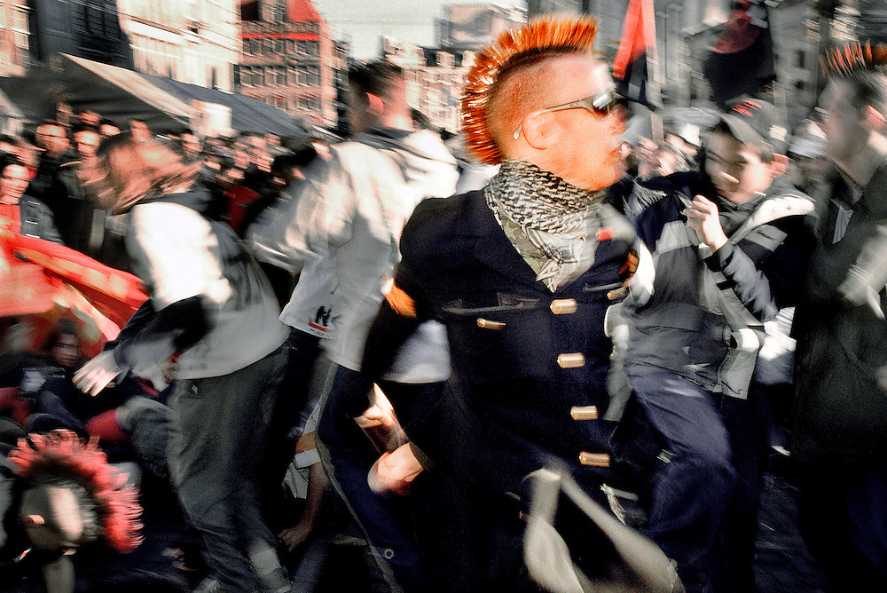 Netherlands. Amsterdam, 02-02-2002. Photo: Patrick Post. Protesters at the 'White Square' waiting for the Golden Carriage containing royal Prince Willem Alexander and Argentinian Maxima Zorreguieta and take action against their wedding. The protesters dance to hard punk music.