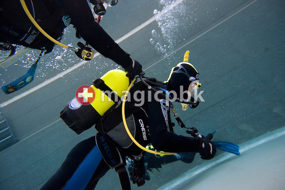 Diver Joel SPIRIG of Switzerland is pictured during a PADI scuba diving training lesson while his dive instructor is turning off his air in the outdoor pool in Gossau, ZH, Switzerland, Monday, May 26, 2008. (Photo by Patrick B. Kraemer / MAGICPBK)