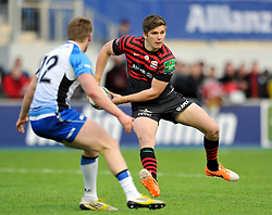 Owen Farrell (Saracens) looks to pass the ball - Photo mandatory by-line: Patrick Khachfe/JMP - Tel: Mobile: 07966 386802 18/01/2014 - SPORT - RUGBY UNION - Allianz Park, London - Saracens v Connacht Rugby - Heineken Cup.