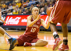 Oklahoma Sooners guard Peyton Little (10) passes the ball to a teammate against the West Virginia Mountaineers during the first half at the WVU Coliseum.