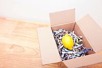 Lemon wrapped up in a box