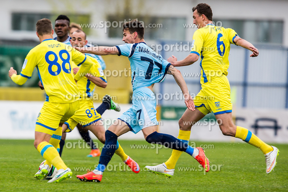Dino Martinovic of ND Gorica and Uros Korun & Kenan Horic & Benjamin Morel of NK Domzale during football match between NK Domzale and ND Gorica in 28th Round of Prva liga Telekom Slovenije 2014/15, on April 18, 2015 in Sports park Domzale, Slovenian. . (Photo by Grega Valancic / Sportida.com)