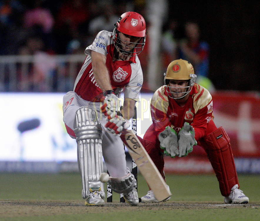 DURBAN, SOUTH AFRICA - 1 May 2009. Simon Katich plays a shot with Mark Boucher looking on during the IPL Season 2 match between Kings X1 Punjab and the Royal Challengers Bangalore held at Sahara Stadium Kingsmead, Durban, South Africa..