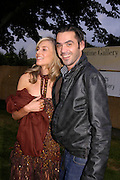 Kim Hersov and Roland Mouret. The Serpentine Summer party co-hosted by Jimmy Choo. The Serpentine Gallery. 30 June 2005. ONE TIME USE ONLY - DO NOT ARCHIVE  © Copyright Photograph by Dafydd Jones 66 Stockwell Park Rd. London SW9 0DA Tel 020 7733 0108 www.dafjones.com