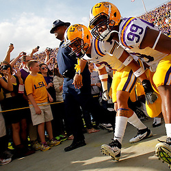 November 25, 2011; Baton Rouge, LA, USA;  LSU Tigers cornerback Tyrann Mathieu (7) and defensive end Sam Montgomery (99) walk out of the tunnel prior to kickoff of a game against the Arkansas Razorbacks at Tiger Stadium. LSU defeated Arkansas 41-17. Mandatory Credit: Derick E. Hingle-US PRESSWIRE