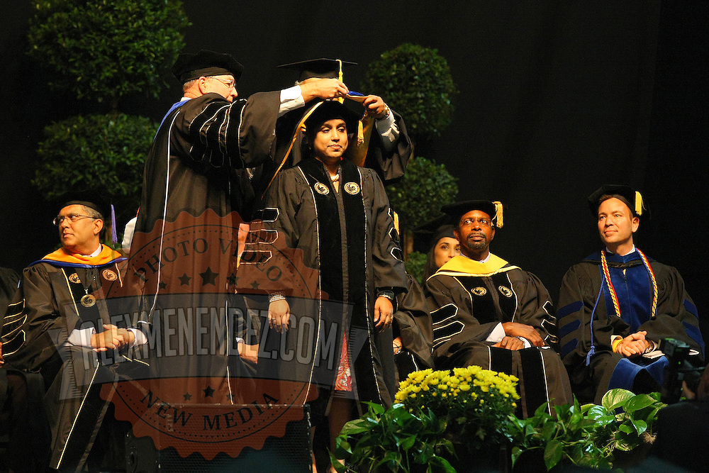 A student graduates during UCF's College of Health and Public Affairs and the College of Medicine's Burnett School of Biomedical Sciences Commencement ceremony at the UCF Arena on Thursday, May 2, 2013 in Orlando, Florida.  (AP Photo/Alex Menendez)