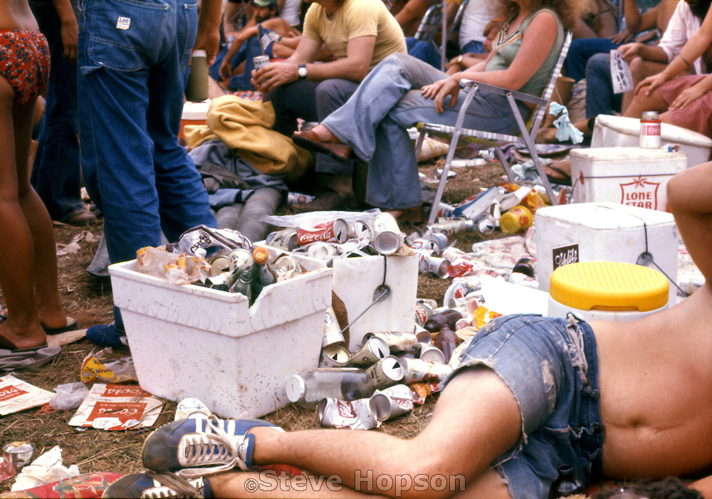 A concert goer lying among the trash at Willie Nelson's 4th of July Picnic, Gonzales Texas, 1976. Willie Nelson's 1976 picnic in Gonzales drew the largest crowd of all his annual picnics at more than 80,000 fans.