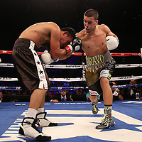 Nestor Bravo fights Sergio Gomez during the Top Rank boxing event at Osceola Heritage Park in Kissimmee, Florida on September 23, 2016.