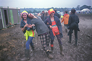 Female Ravers in muddy field at Glastonbury Festival 1992.