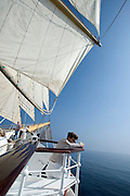 The Tyrrhenian Sea seen from aboard Royal Clipper. Passenger enjoying the view.