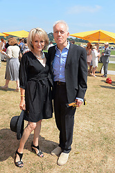 NICKOLAS GRACE and CLARE FRANCIS at the Veuve Clicquot Gold Cup, Cowdray Park, Midhurst, West Sussex on 21st July 2013.