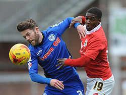 Bristol City's Kieran Agard challenges for the ball with Rochdale's Thomas Kennedy - Photo mandatory by-line: Dougie Allward/JMP - Mobile: 07966 386802 - 28/02/2015 - SPORT - football - Bristol - Ashton Gate - Bristol City v Rochdale AFC - Sky Bet League One