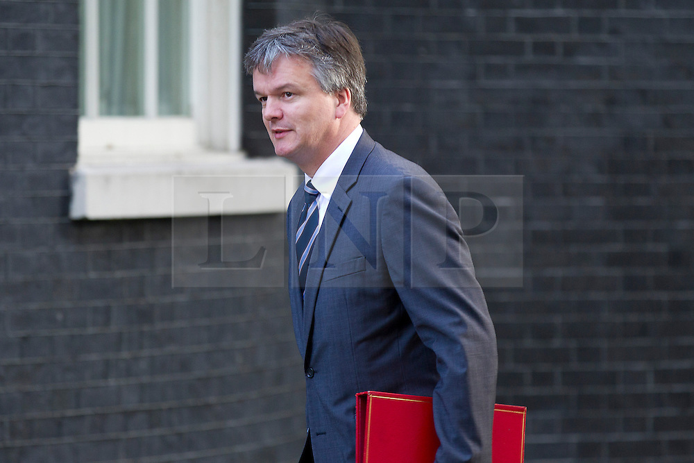 © Licensed to London News Pictures. 16/10/2012. LONDON, UK. Michael Moore, the Scottish Secretary, is seen on Downing Street in London for today's (16/10/2012) meeting of David Cameron's cabinet. Photo credit: Matt Cetti-Roberts/LNP