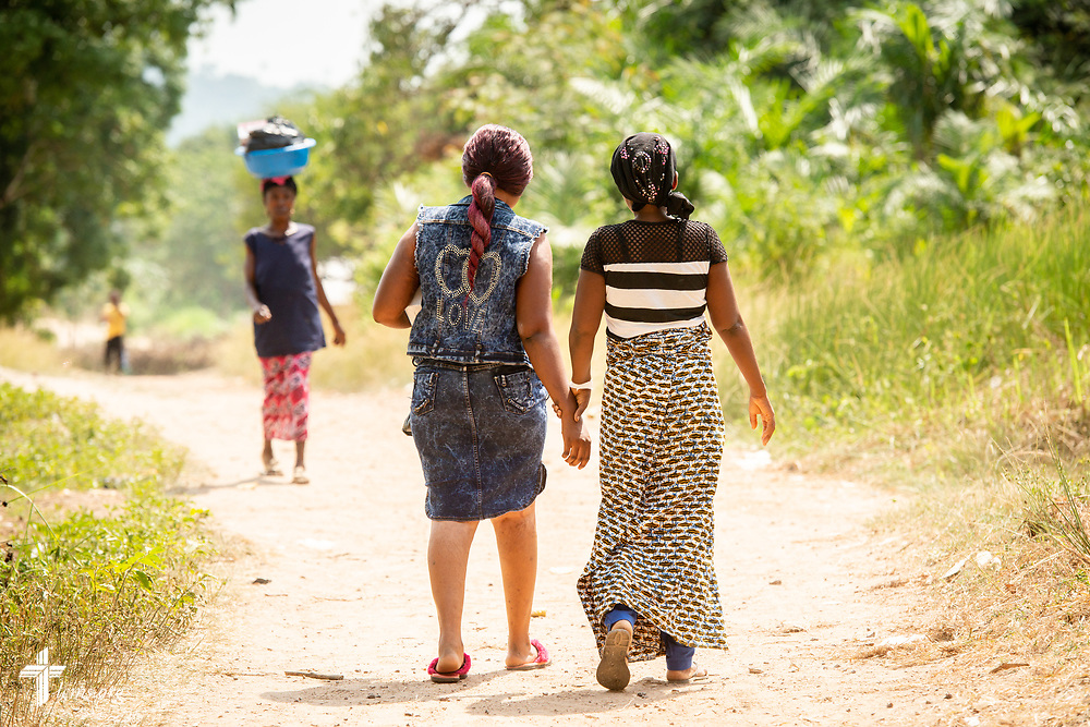 Fatmata (right) leaves the clinic with her sister following treatment on the fifth day of the LCMS Mercy Medical Team on Friday, May 11, 2018, in the Yardu village outside Koidu, Sierra Leone, West Africa. LCMS Communications/Erik M. Lunsford