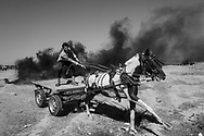 A wounded Palestinian is rushed on a horse cart to an ambulance from the border fence with Israel as mass demonstrations continue on May 14, 2018 in Gaza City, Gaza. Israeli soldiers killed at least 62 Palestinians and wounded over a thousand as the demonstrations coincided with the controversial opening of the U.S. Embassy in Jerusalem. This marks the deadliest day of violence in Gaza since 2014.