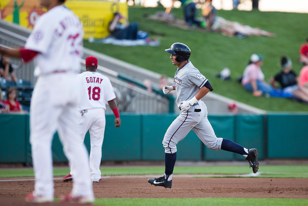 Lane Adams (8) of the Northwest Arkansas Naturals rounds the bases after hitting a home run during a game against the Springfield Cardinals at Hammons Field on August 20, 2013 in Springfield, Missouri. (David Welker)