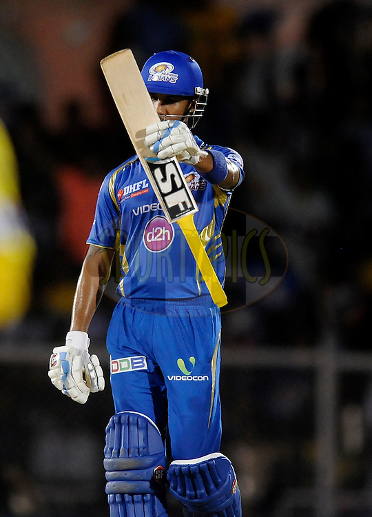 Lendl Simmons of the Mumbai Indians acknowledges teammates after scoring a half century during the eliminator match of the Pepsi Indian Premier League Season 2014 between the Chennai Superkings and the Mumbai Indians held at the Brabourne Stadium, Mumbai, India on the 28th May  2014<br /> <br /> Photo by Pal PIllai / IPL / SPORTZPICS<br /> <br /> <br /> <br /> Image use subject to terms and conditions which can be found here:  http://sportzpics.photoshelter.com/gallery/Pepsi-IPL-Image-terms-and-conditions/G00004VW1IVJ.gB0/C0000TScjhBM6ikg