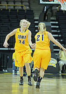December 30, 2011: Iowa Hawkeyes guard Jaime Printy (24) congratulates Iowa Hawkeyes guard Melissa Dixon (21) after a three point basket during the NCAA women's basketball game between the Northwestern Wildcats and the Iowa Hawkeyes at Carver-Hawkeye Arena in Iowa City, Iowa on Wednesday, December 30, 2011.
