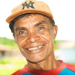Portrait of a smiling papuan man.