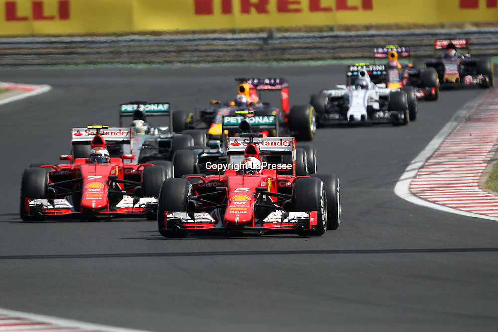 &copy; Photo4 / LaPresse<br /> 26/07/2015 Budapest, Hungary<br /> Sport <br /> Grand Prix Formula One Hungary 2015<br /> In the pic: restart after Safety car, Sebastian Vettel (GER) Scuderia Ferrari SF15-T and Kimi Raikkonen (FIN) Scuderia Ferrari SF15-T lead