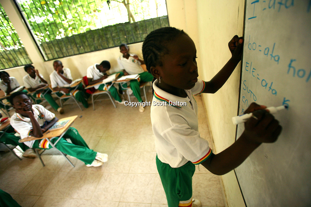 A students writes out an assignment on the board during a local language class in Palenquero, in San Basilio de Palenque, in northern Colombia, about 50 kilometers outside of Cartagena, on Tuesday, October 9, 2007. The classes are part of the efforts underway in San Basilio de Palenque, which was founded by runaway slaves at the beginning of the 17th century, to save their unique local language. (Photo/Scott Dalton).