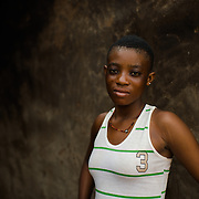 Akala, pictured in the Upper West Region of Ghana on 27 May 2014, completed primary school, but was unable to continue her education because there is no high school in her community. The nearest Junior High School is an 18-kilometre walk away, at the end of a track that becomes impassable during the rainy season.