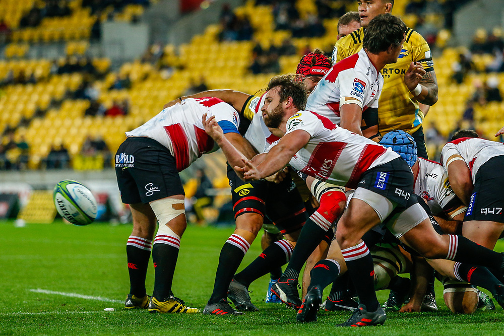 Nic Groom passes  during the Super rugby (Round 12) match played between Hurricanes  v Lions, at Westpac Stadium, Wellington, New Zealand, on 5 May 2018.  Hurricanes won 28-19.