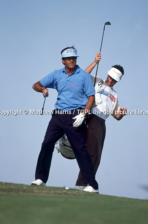 Seve BALLESTEROS (ESP) during fourth round Dubai Desert Classic 1992,Emirates Club, Dubai,UAE.In winning this event he made it his 50th tournament win on the European Tour in his career, shown here with his caddie Billy Foster.