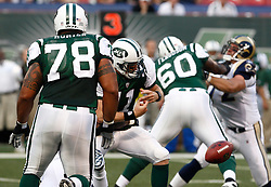 Aug 14, 2009; East Rutherford, NJ, USA;   New York Jets quarterback Kellen Clemens (11) fumbles during the first half at Giants Stadium.