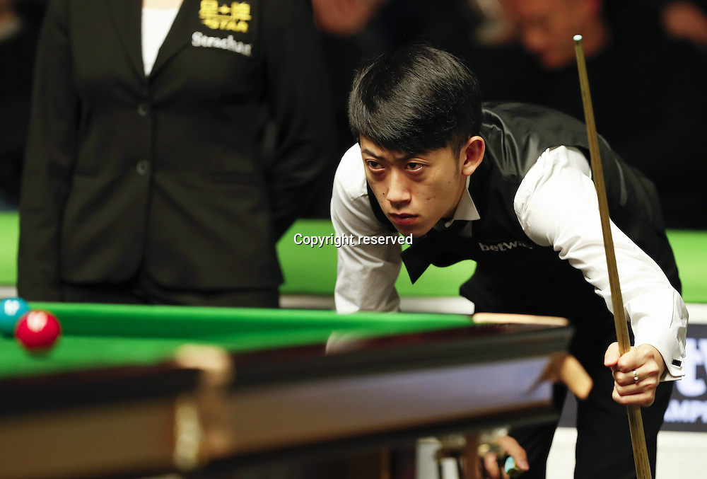 23.11.2016. York, Yorkshire, England.  Chen Zhe of China reacts during the first round match with Mark Allen of Northern Ireland at the Snooker UK Championship in York, Britain on Nov. 23, 2016. Chen lost 4-6.