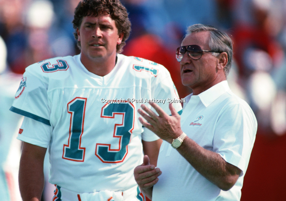 Miami Dolphins head coach Don Shula talks to Miami Dolphins quarterback Dan Marino (13) on the sideline during the NFL football game against the Buffalo Bills on Oct. 29, 1989 in Orchard Park, N.Y. The Bills won the game 31-17. (©Paul Anthony Spinelli)